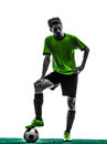 Soccer football player young man silhouette one standing in studio on white background Royalty Free Stock Images