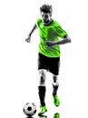 Soccer football player young man silhouette one in studio on white background Stock Photos