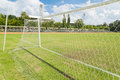 Soccer goal net in football field grass Royalty Free Stock Photography