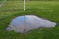 Soccer goal puddle a reflected in a Royalty Free Stock Images