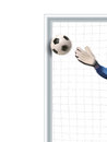 Soccer goalkeeper trying to defend and deflecting the shot the post Royalty Free Stock Photo