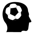 Soccer imagination a black silhouette of a human head with a ball inside Stock Image