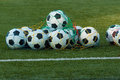 Soccer a lot of balls for on a field of artificial grass for training football team Royalty Free Stock Photo
