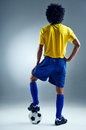 Soccer man challange world cup brazil standing ready to compete with ball Royalty Free Stock Photo