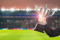 Soccer manager team holding trophy champions in the stadium. Royalty Free Stock Photo