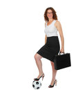 Soccer mom and business woman in attire with one foot on a ball futbol Stock Photos