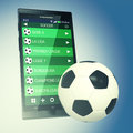 Soccer and new communication technology smartphone with a sport app with the most important leagues a ball concept of sport d Royalty Free Stock Photo