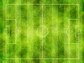 Soccer pitch overhead view of or football with textured green grass in stripes Royalty Free Stock Image