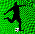 Soccer player on abstract background silhouette green Royalty Free Stock Photo