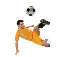 Soccer player in action isolated over white background Stock Photography