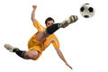 Soccer player in action kicking ball while jumping isolated over white background Stock Images