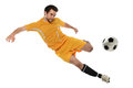 Soccer player in action young kicking ball isolated over white background Stock Photos