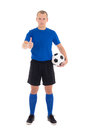 Soccer player with a ball thumbs up on white background in blue uniform Royalty Free Stock Photos