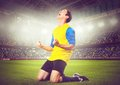 Soccer player or football is celebrating goal on stadium Royalty Free Stock Photo