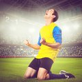 Soccer player or football is celebrating goal on stadium warm colors toned Royalty Free Stock Photography