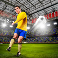 Soccer player or football is kicking ball on stadium Royalty Free Stock Image
