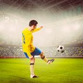 Soccer player or football is kicking ball on stadium Royalty Free Stock Photo