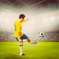 Soccer player or football is kicking ball on stadium warm colors toned Royalty Free Stock Photos