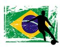 Soccer player in front of the brazil flag Royalty Free Stock Photos