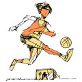Soccer player kicking ball an image of a the with goalie in background Royalty Free Stock Image