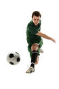 Soccer player kicking ball isolated over white background Royalty Free Stock Photography