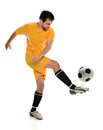 Soccer player kicking ball isolated over white background Stock Photography