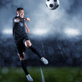 Soccer Player Kicking Ball In ...