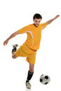Soccer player kicking ball young isolated over white background Royalty Free Stock Images