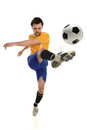 Soccer player kicking ball young isolated over white background Royalty Free Stock Photography