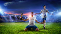 Soccer player at stadium. Mixed media Royalty Free Stock Photo
