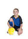 Soccer player ten year old boy with a ball isolated on white background Stock Photo