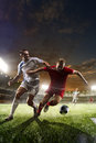Soccer players in action on sunset stadium background Royalty Free Stock Photo