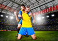 Soccer players or football are celebrating goal on stadium Stock Photos