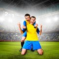 Soccer players or football are celebrating goal on stadium Royalty Free Stock Photos