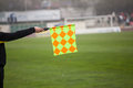Soccer referee hold the flag offside trap Stock Images