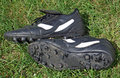 Soccer shoes on grass Stock Images