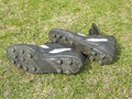 Soccer shoes on green grass Royalty Free Stock Photo