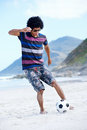 Soccer skill beach hispanic brasil man playing on with dribble and ball on vacation Royalty Free Stock Photo