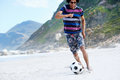 Soccer skill beach hispanic brasil man playing on with dribble and ball on vacation Royalty Free Stock Images