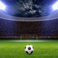 Soccer stadium statium ball on green arena in night illuminated bright spotlights goal Stock Photo