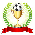 Soccer trophy on glowing background champion gold with ball green laural wreath and red banner botton Royalty Free Stock Photography