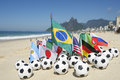 Soccer world cup brazil international team flags rio with footballs on the beach in de janeiro Royalty Free Stock Photos