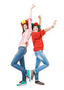 Soccer young girl fans dancing in spanish and portuguese hats Royalty Free Stock Photo