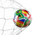 Soccerball with flags in net Royalty Free Stock Photo