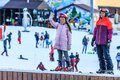 Sochi, Russia - January 7, 2018: Female ski instructor teaches skiing to small girl on snowy mountain slope in Gorky Gorod winter Royalty Free Stock Photo