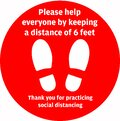 Social Distancing or Safe Distancing Floor Sticker for stores and supermarkets to help reduce the spread of covid-19 coronavirus Royalty Free Stock Photo