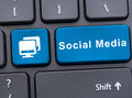 Social media on blue button on keyboard Royalty Free Stock Photo