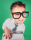 Social media concept five years old boy with a laptop computer Stock Images
