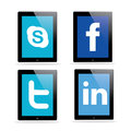 Social media icons in ipad with isolated background Royalty Free Stock Images