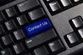 Social media key button on a keyboard showing the contact icon Royalty Free Stock Photography